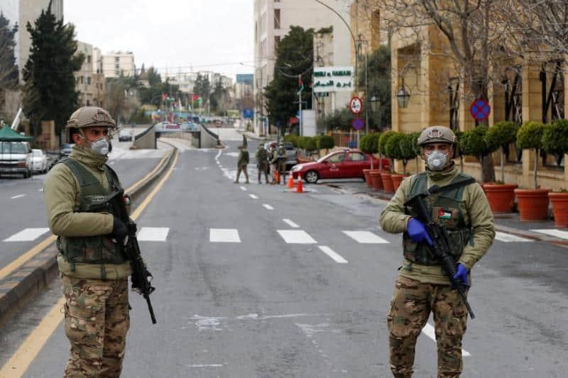 Jordanian army members stand guard