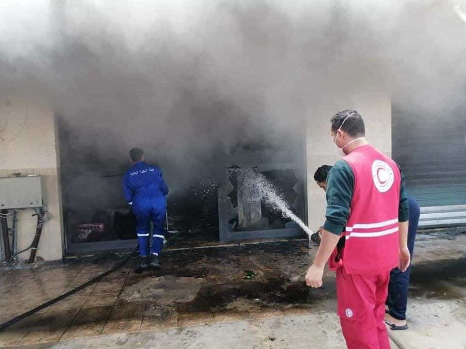 Libyan Red Crescent putting out fires caused by fighting on Libya's western coast